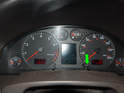 With the car turned off, press the right button on the instrument cluster (green arrow) and hold it in.