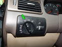 Turn the headlight switch to the off position and push the knob inward (green arrow).