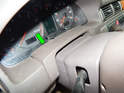Pull the cover piece (green arrow) off the top of the steering column.