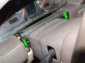 Remove the two 8mm bolts (green arrows) holding the dashboard panel on.