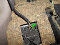 Squeeze the two mounting tabs (green arrow) on the OBD2 connector and pull it out of the panel.