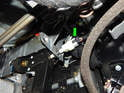 Pull the electrical connector off the back of the brake light switch (green arrow).