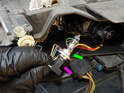 Headlight Assembly: Once the low beam bulb (green arrow) is free, pull the electrical connector (purple arrow) off.