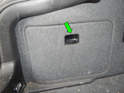 Taillights: Press the tab (green arrow) on the trunk rear access panels and remove them from the car.