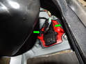 Press the two tabs on the bulb carrier (green arrows) and pull the bulb carrier out of the taillight lens.