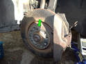 Use one of the lug bolts (green arrow) to hold the brake disc to the wheel hub.