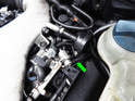 Remove the vacuum hose (green arrow) that attaches to the nipple on the fuel pressure regulator.