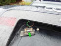 Pull the bulb holder out of the trunk lid.