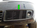 Left and Right sides: Pull the plastic grille cover (green arrow) out of the front bumper.