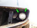 Left and Right sides: Loosen and remove the two Phillips head screws (green arrows) securing the fog light assembly to the chassis.