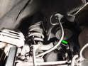 Rear: Shown here is the rear brake line (green arrow).