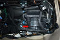 With the glove box removed you can see the blower motor in the housing (red arrow).
