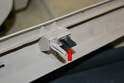 The sill trim piece is just a series of metal clips (red arrow); use your trim removal tool and gently pry it up and out.