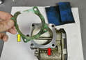 Make sure you remove the old gasket (yellow arrow) and clean the two mounting surface (red arrow) areas well.