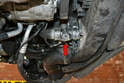The coolant temperature sensor is located on the lower left side of the cooling system.