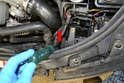 The second is located between the upper radiator hose and the assembly; again use a T30 Torx and just loosen the bolt a few turns (red arrow).