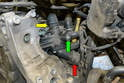 Directly behind the alternator is the thermostat and thermostat housing.
