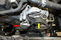 Next, remove the accessory belt (yellow arrow) and belt tensioner (red arrow).