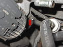Remove the vacuum line near the throttle body (red arrow) that goes to the charcoal container.
