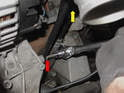 Loosen but do not remove the support rod for the intake (red arrow).