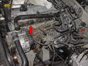 Remove the intake manifold by rocking it gently until the gasket lets go (red arrow) and then pull the manifold straight back off the head.