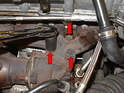You can remove the turbo from the exhaust manifold by removing the three 15mm bolts (red arrows) and remove the head with the exhaust attached or remove the exhaust manifold from the head.