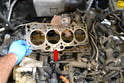Remove the old head gasket and install a new one (red arrow), making sure it is seated correctly.