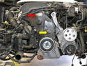 There are two covers on the front of the motor protecting the timing belt; the upper (red arrow) and the lower (yellow arrow).