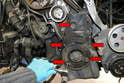 Use a 19mm socket and remove the five 10mm bolts holding the lower timing cover in place.