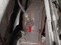 The best place to begin is by using a 22mm wrench or the 22mm craw-foot socket and remove the O-2 sensor from the top of the catalytic converter (red arrow).
