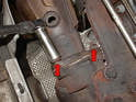 Use a 17mm socket and remove the three nuts holding the cat (catalytic converter) pipe to the turbo (red arrows, two shown).