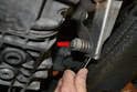 There is a 13mm nut and bolt that passes through a spring (red arrow) to eliminate vibrations.