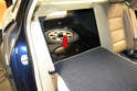 Access to the pump/level sender unit on the front wheel drive vehicles is through an access panel in the trunk area.