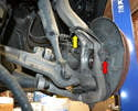 Front Sensor- The front wheel speed sensor is mounted on the wheel bearing housing (red arrow).