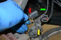 With the sensor disconnected release the locating plastic pin on the sensor from the mount (yellow arrow) by gently prying it out and then turn the sensor connection sideways (red arrow) and remove it from the metal mount on the caliper.