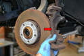 Remove the caliper mounting bracket (red arrow) from the bearing housing.