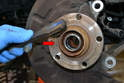 Make sure to clean the flange of the hub with a wire brush or wire wheel to give the new rotor a flat surface to mount to (red arrow).