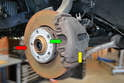 You will need to remove the brake caliper (yellow arrow), pads (green arrow) and rotor (red arrow).