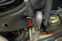 Use an 18mm socket to hold the bolt (yellow arrow) and remove the 18mm nut using a wrench (red arrow).