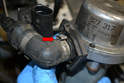 The hoses come from the factory with a special clamp (red arrow).