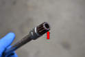 You must use a 16mm XZN socket to remove the drain plug (red arrow).