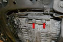 Remove the two 13mm bolts (red arrows) that mount the filter to the left side of the transmission.