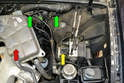 You will need to remove the coolant overflow reservoir (red arrow) to access the brake pressure sensor, but you do NOT need to drain the coolant to do this.