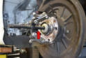 Reinsert the bolt back into the bearing carrier to use a press point for the puller.
