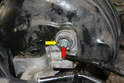 The master cylinder is attached to the booster by an E10 Torx bolt (red arrow) inside of the 22mm nut (yellow arrow).