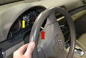 Turn the wheel 90 degrees to give you more room to get the Torx driver between the wheel and instrument cluster (yellow arrow).