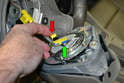 Lift up the yellow safety connection (red arrow) from the connection base and then gently pull the wiring connection from the air bag (green arrow).