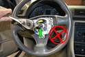 Insert your 12-point socket into the steering bolt (green arrow) and remove the bolt.