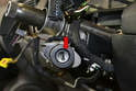 You will need a firm paper clip or 3/36 drill bit to inset into the hole in the ignition cylinder (red arrow).