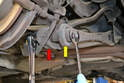 Tie Rod- Use an 18mm socket and wrench and remove the single long bolt that holds the tie rod (yellow arrow) and wheel bearing housing to the trailing arm (red arrow).